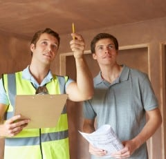 Two inspectors completing a routine new home inspection