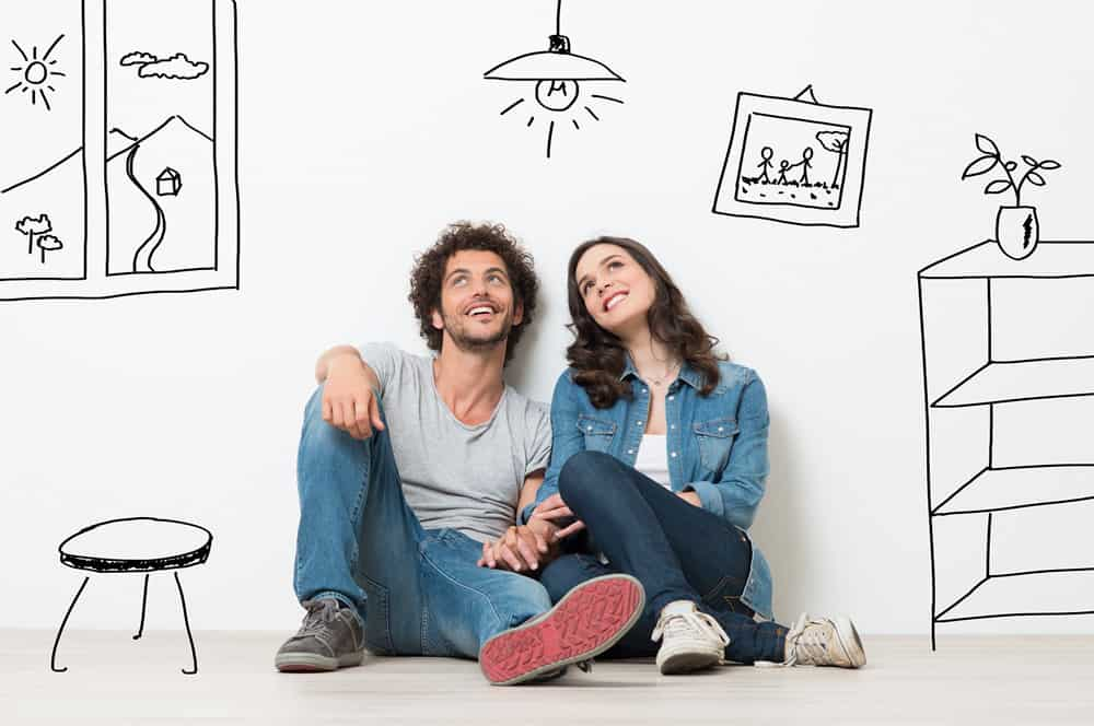 Happy couple dreaming about the right home for them | Guide to Purchasing a New Home