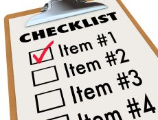 Mortgage Application checklist on a wood and metal clipboard with a check next to t