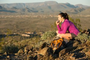 A Hiker Sitting on Top Of The Desert Trail in Paradise Valley, Arizona