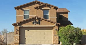 Affordable Arizona home with a tan garage